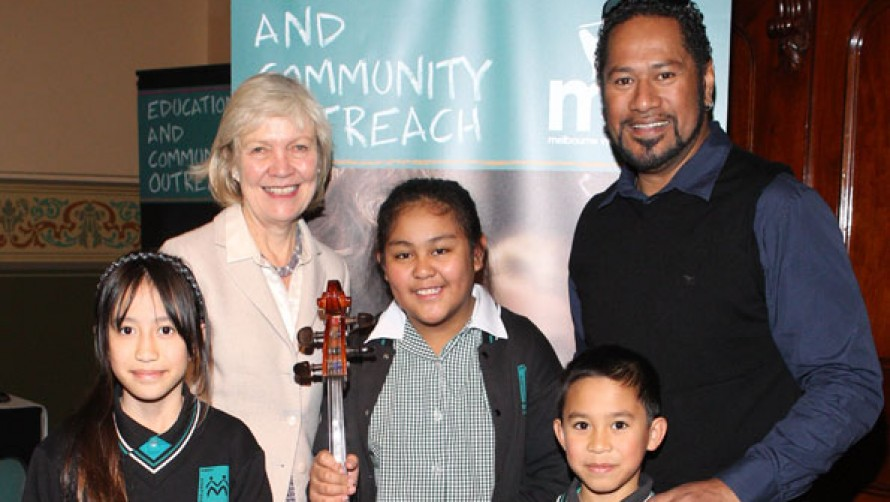 Students from the Pizzicato Effect and Mrs Chernov with Jay Laga'aia at 2012 Education Week
